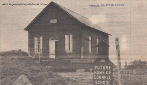A photo of the Cornell School sitting on jacks at its new location.