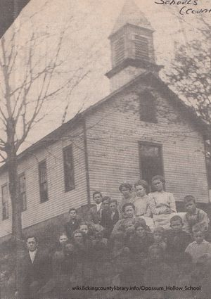 A photo of Opossum Hollow School and students.